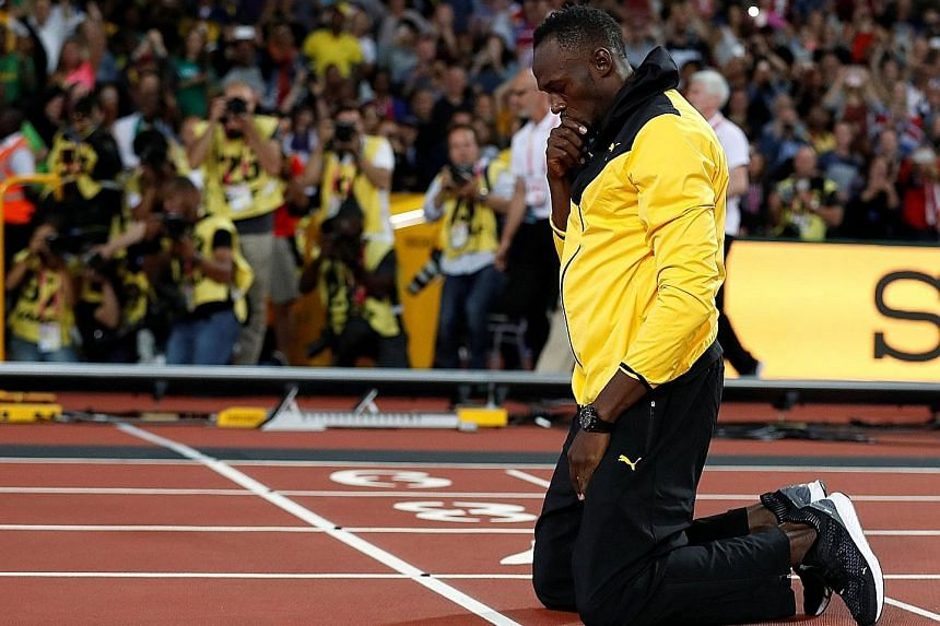 Jamaican great Usain Bolt kneeling down before doing a lap of honour at the World Athletics Championships. He bows out as arguably the greatest track and field athlete of all time.