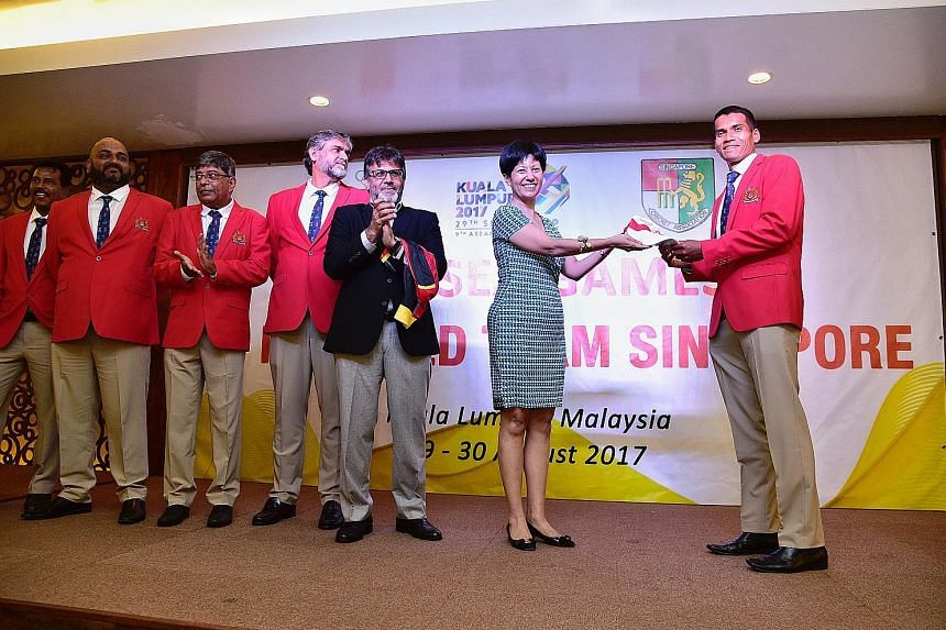 Anish Paraam, captain of the Singapore SEA Games men's cricket team, receiving his cap yesterday from […]Senior Minister of State for Law and Finance Indranee Rajah, the new adviser to the Singapore Cricket Association. Applauding the presentation