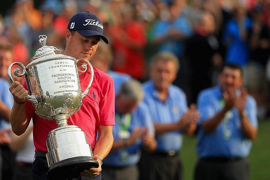 Justin Thomas holding the Wanamaker Trophy after winning the PGA Championship by two strokes. It was the American's first Major title, after coming close in June's US Open..