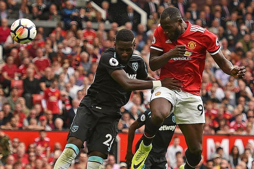 Manchester United striker Romelu Lukaku (No. 9) heading his side's second goal in the 52nd minute. He has made an encouraging start to his Old Trafford career despite lofty expectations as United's second-most expensive transfer and will likely lead