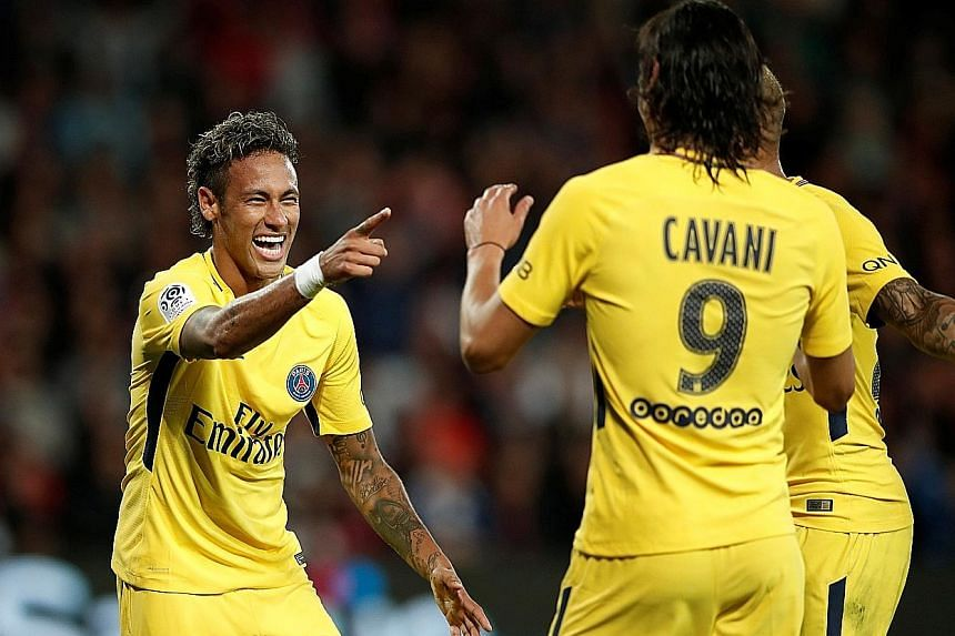 Paris Saint-Germain forward Neymar celebrating his debut goal and his club's third against French Ligue 1 side Guingamp with Uruguayan striker Edinson Cavani. The Brazilian international will be hoping to fire PSG to Champions League glory this seaso