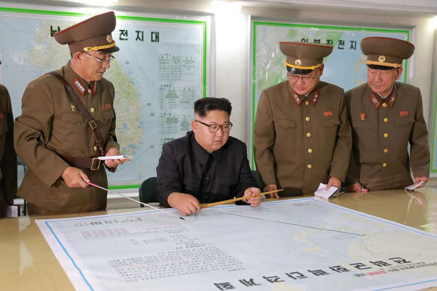 North Korean leader Kim Jong Un visits the Command of the Strategic Force of the Korean People's Army (KPA) in an unknown location in North Korea in this undated photo released by North Korea's Korean Central News Agency (KCNA) on Aug 15, 2017.