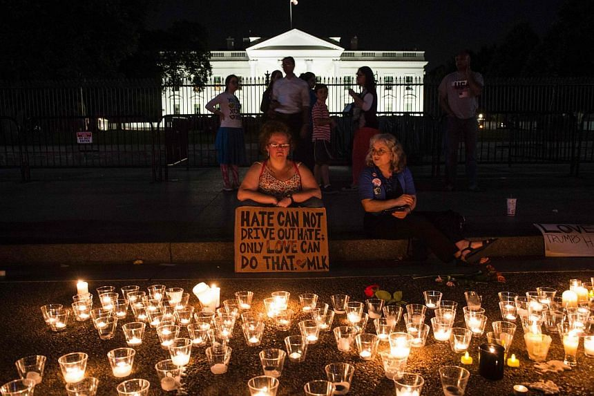 People at a vigil in response to the death of a counter-protestor in the Aug 12 Unite the Right rally in front of the White House on Aug 13, 2017.