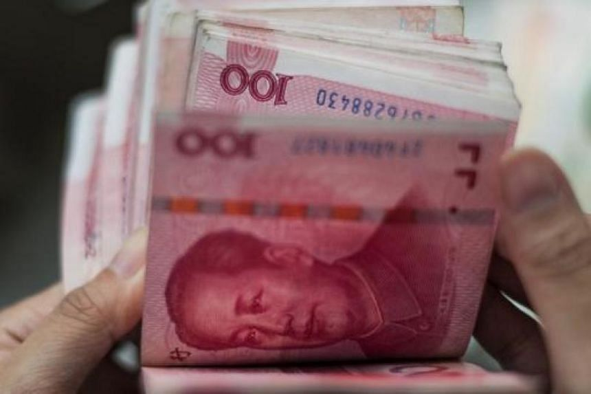 A file picture of Chinese 100 yuan notes in Beijing. PHOTO: AFP