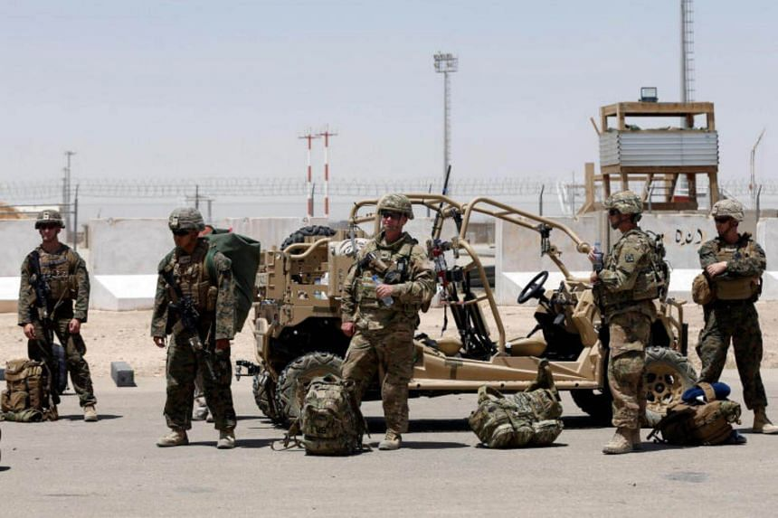US troops wait for airplane at the Camp Bastion in Helman province, Afghanistan.