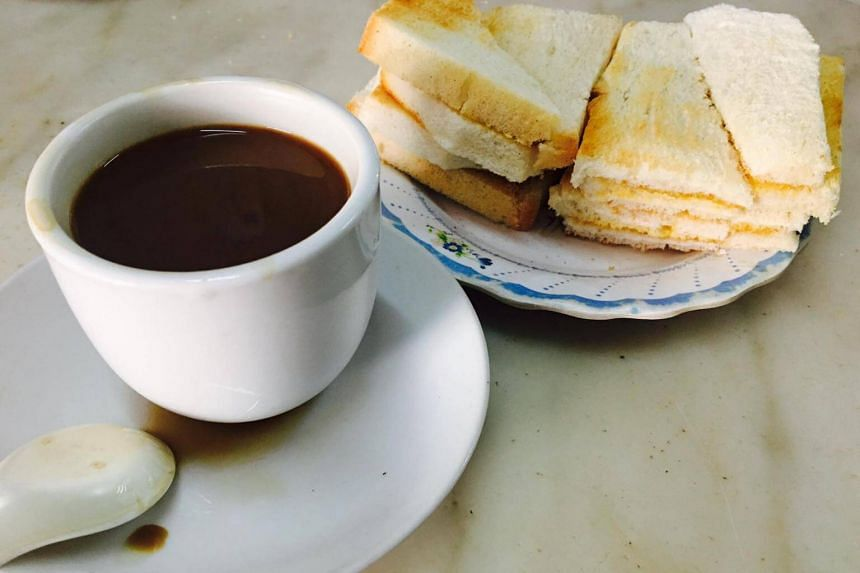 The coffee shop in Jalan Besar is known for kaya toast grilled over a charcoal fire, soft-boiled eggs and traditional sock-brewed coffee and tea.