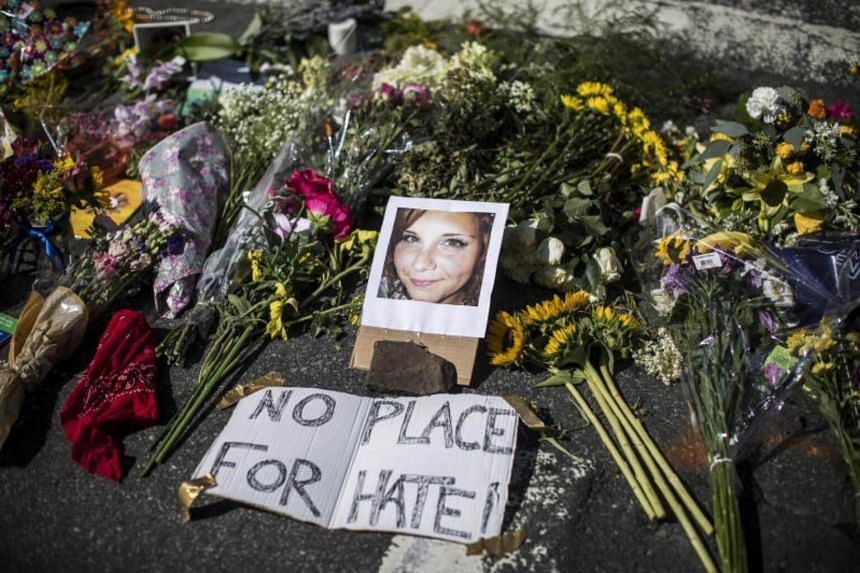A memorial for Heather Heyer at the scene where she was killed when a man drove into a crowd during a protest against a rally of white nationalists in Charlottesville on Aug 13, 2017.