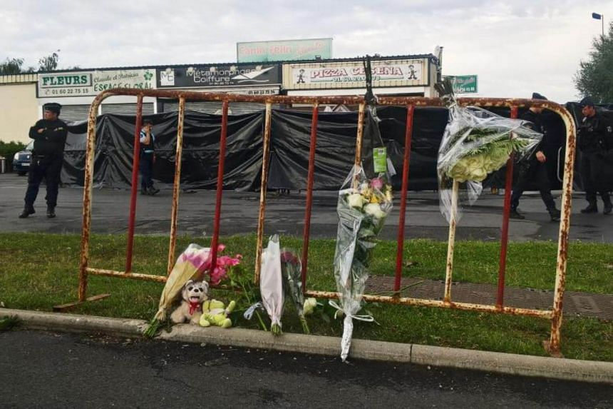 Police officers patrolling next to a makeshift memorial near a pizza restaurant in Sept-Sorts, after a car crash that killed a 13-year-old girl.