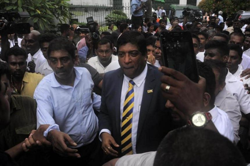 Former Sri Lanka foreign minister Ravi Karunanayake leaving parliament after announcing his resignation, in Colombo on Aug 10, 2017.