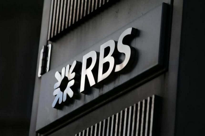 An RBS logo is pictured outside a Royal Bank of Scotland (RBS) bank branch in central London.