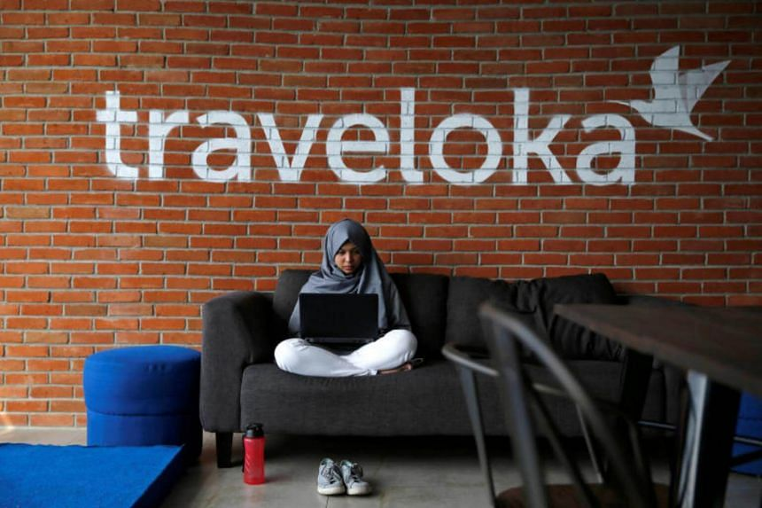 An employee of Traveloka works at the company's headquarters in Jakarta, Indonesia.
