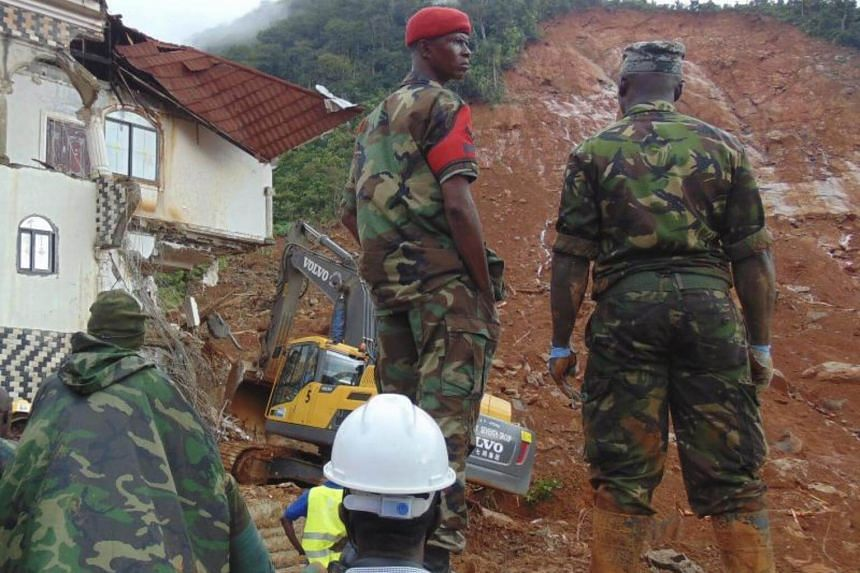 Sierra Leone military view damage caused by a mudslide in the suburb of Regent behind Guma reservoir, Freetown, Sierra Leone on August 14, 2017.