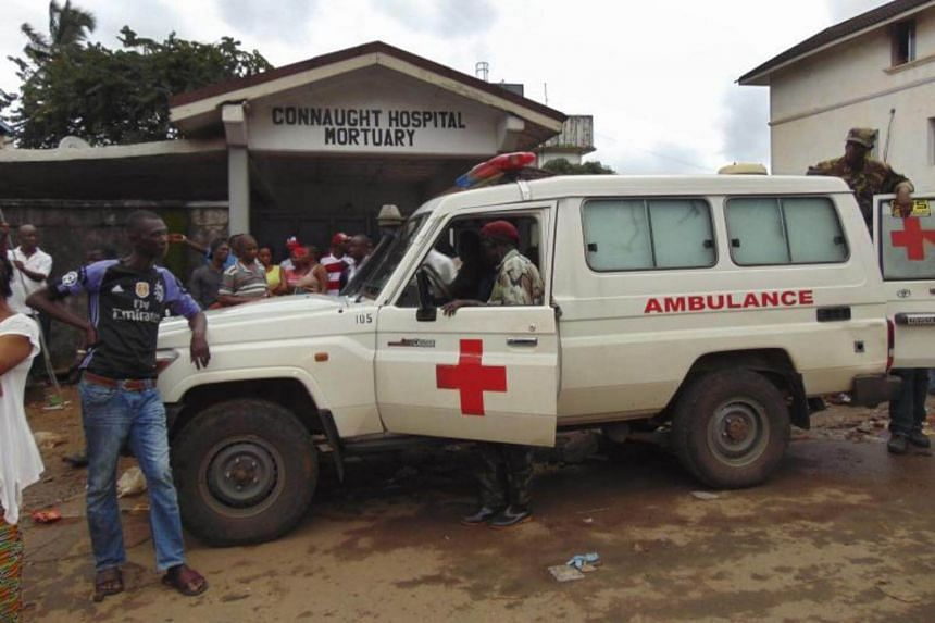 An ambulance arrives at Connaught Hospital Mortuary following a mudslide in the suburb of Regent behind Guma reservoir, Freetown, Sierra Leone on August 14, 2017.