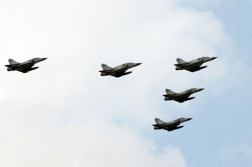 Taiwan Air Force Mirage 2000-5 warplanes fly over the Air Force Academy during Taiwan's Air Force Day celebrations in Kaohsiung, southern Taiwan on Aug 12, 2017.