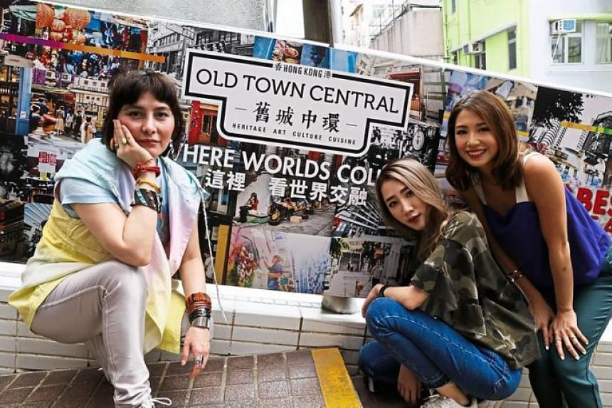 Actress Josie Ho (left) in Hong Kong's Old Town Central with Malaysian Daphne Charice (centre) and Kryz Uy from the Philippines.