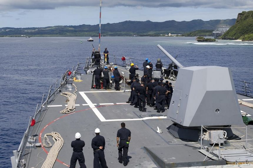 In this image obtained from the US Department of Defense, US sailors aboard Arleigh Burke-class guided-missile destroyer USS Sterett prepare to moor at Naval Base Guam for a scheduled port visit on Aug 4, 2017.