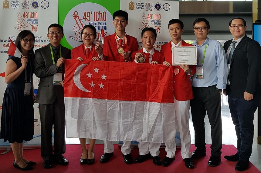 The experts and the team competing in the chemistry olympiad (from left) Madam Ng Yu Rui, Dr Zhang Sheng, Miss Tang Yimian, Mr Lam Tze King, Mr Matthias Liau Yi Quan, Mr Zhang Zhiyuan, Dr Tan Wee Boon and Mr Tham Zi Sheng.