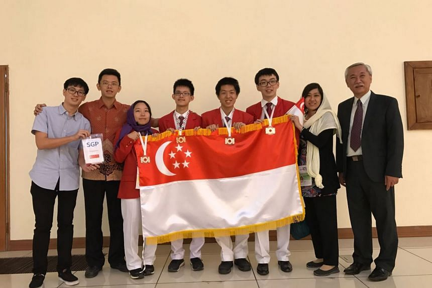 The experts and the team that competed in the informatics olympiad (from left) Mr Lam Yun Shao Ranald, Dr Steven Halim, Ms Lim Li, Mr Huang Xing Chen, Mr Pang Wen Yuen, Mr Zhang Guangxuan, Madam Tan-Moh Tser Ni Eileen and Associate Professor Tan Sun