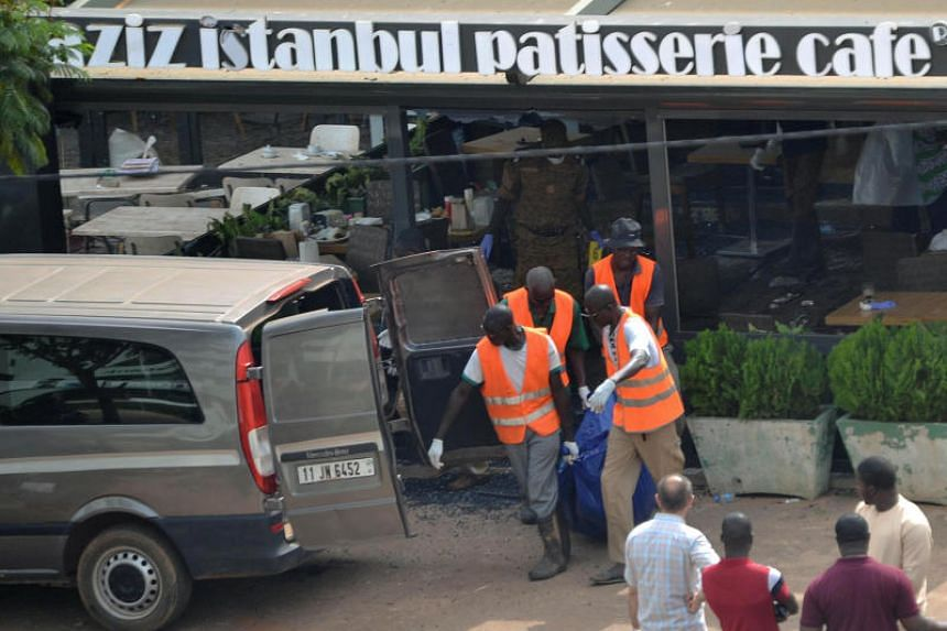 Medical agents transport a dead body at the Aziz Istanbul restaurant after an overnight raid in Ouagadougou, Burkina Faso on Aug14, 2017