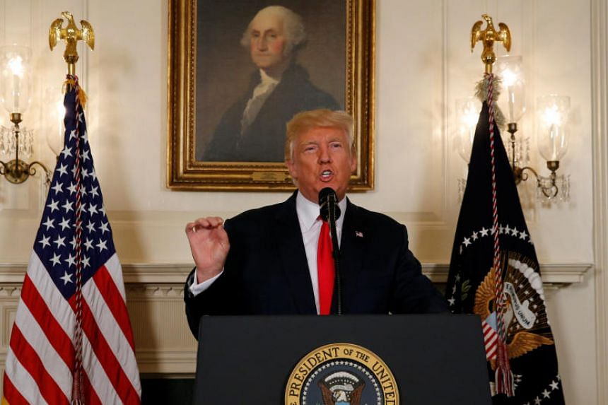 US President Donald Trump delivers a statement on the deadly protests in Charlottesville, at the White House in Washington on August 14, 2017.