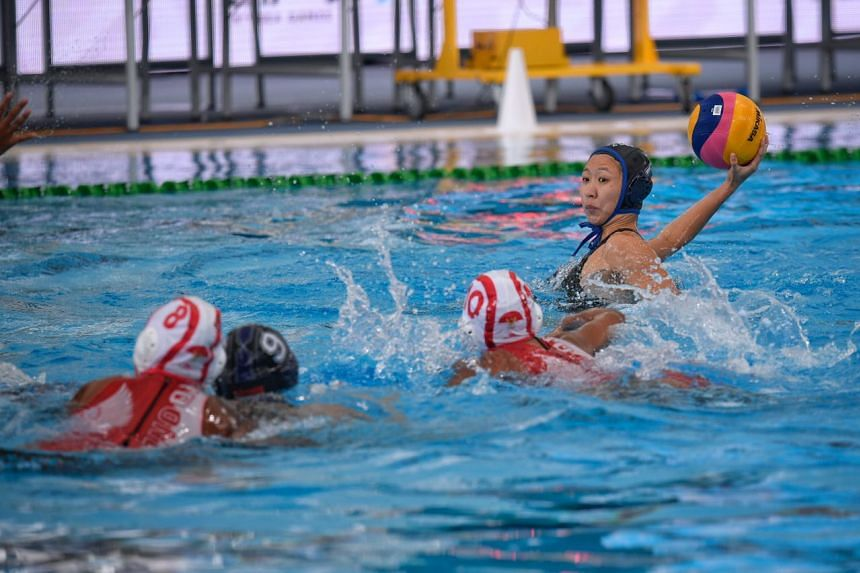 Angeline Teo (right) of Singapore tries a shot against Indonesia during the SEA Games Women's water polo match held at the National Aquatic Centre at Bukit Jalil on Aug 15, 2017.
