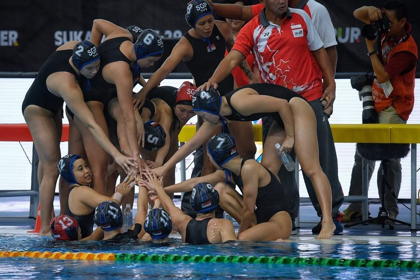 The Singapore Women's water polo team huddles together during the SEA Games Women's water polo match against Indonesia on Aug 15, 2017.