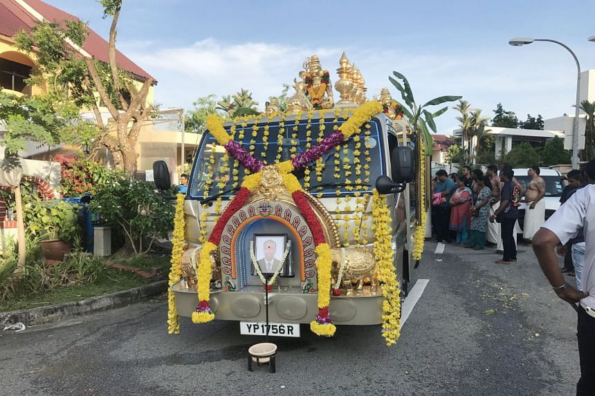 The hearse that will bear Mr Rajadanran Suppiah's body at the wake in Lentor Terrace. Mr Rajadanran died of cardiac arrest after collapsing while jogging along the MacRitchie Nature Trail last Saturday.