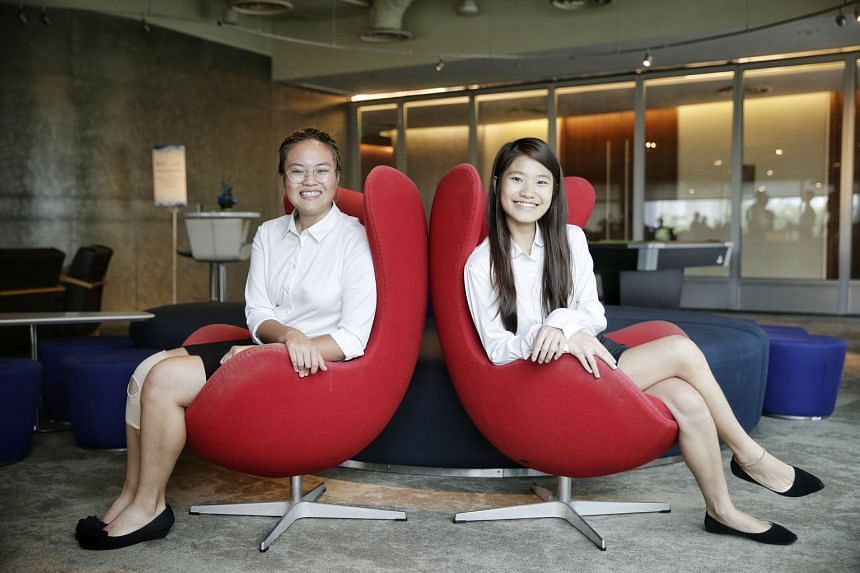 Quantedge Foundation scholarship holders Lee Wen Hui (left) and Joyce Lee are among the 13 students who have received the bond-free scholarship this year.