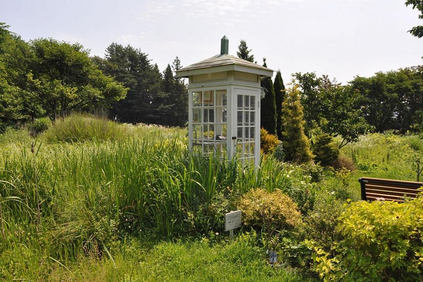 A disconnected telephone called Kaze no Denwa, or the Phone of the Wind, stands in a booth on a small hill in Otsuchi, Iwate Prefecture.