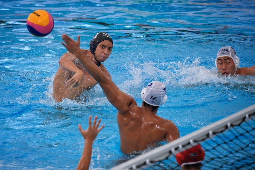Yip Yang of Singapore tries a shot during the SEA Games Men's Water Polo match against Thailand at the National Aquatic Centre, on Aug 16, 2017.