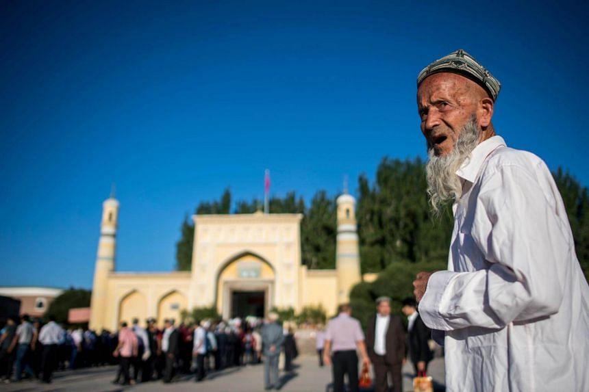 A Muslim man arriving at the Id Kah Mosque for the morning prayer on Eid al-Fitr in the old town of Kashgar in China's Xinjiang Uighur Autonomous Region, on June 26, 2017.