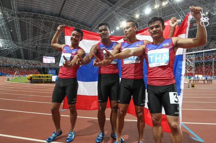 (From left) The Thai men's 4x100m team, comprising of Sowan Ruttanapon, Promkaew Aphisit, Meenapra Jirapong and Sathoengram Jaran, celebrating after their win in the race at the Sports Hub in June 2015.