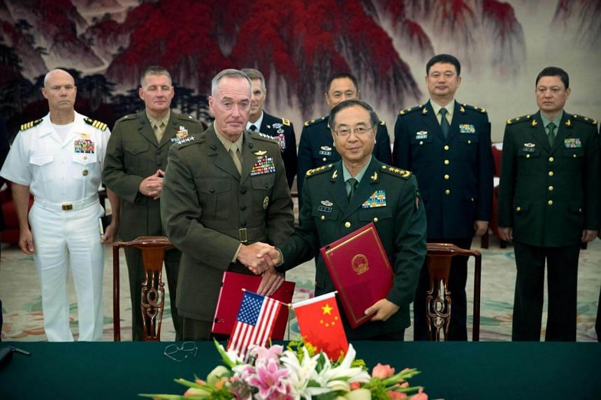 General Joe Dunford (front left), chairman of the US Joint Chiefs of Staff, and China's General Fang Fenghu, who is chief of the Joint Staff Department, after signing an agreement at the Bayi Building in Beijing on Aug 15.