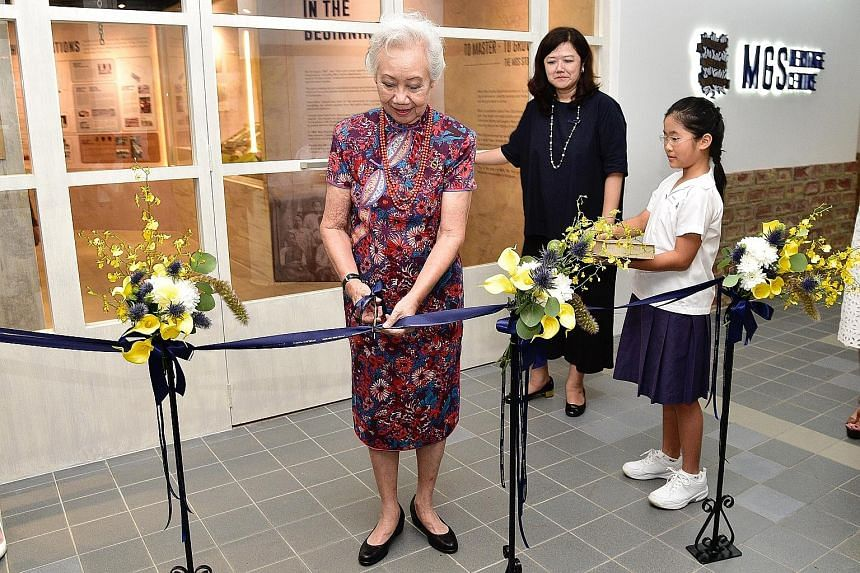 Mrs Anna Tham, the longest-serving principal of Methodist Girls' School - from 1977 to 1994 - at the official opening of the newly renovated heritage centre yesterday, with MGS Alumnae Association president Tjio Bee Ann.