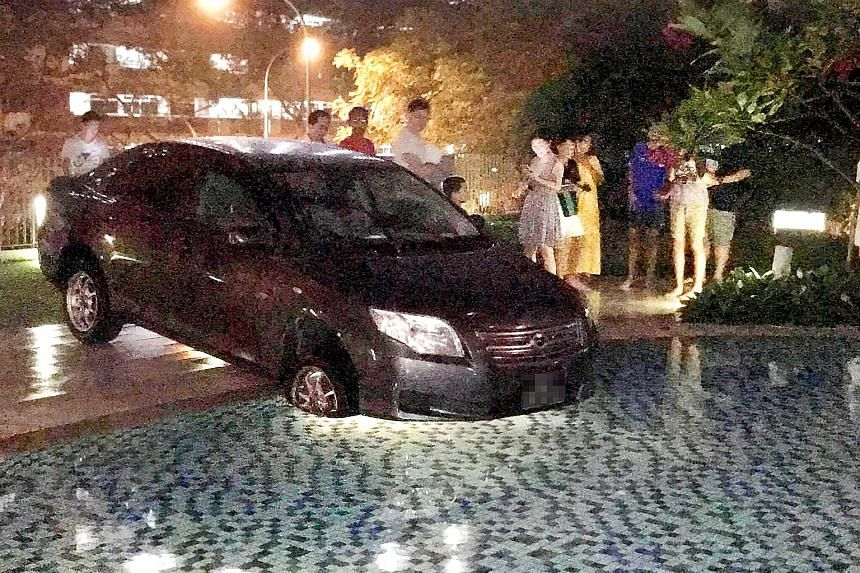 The car was left at the edge of SkyPark Residences' pool, with its front two tyres in the water on Aug 8. It was towed out at about 1am on Aug 9. The condo's management committee is conducting a review to see if more signage is required.