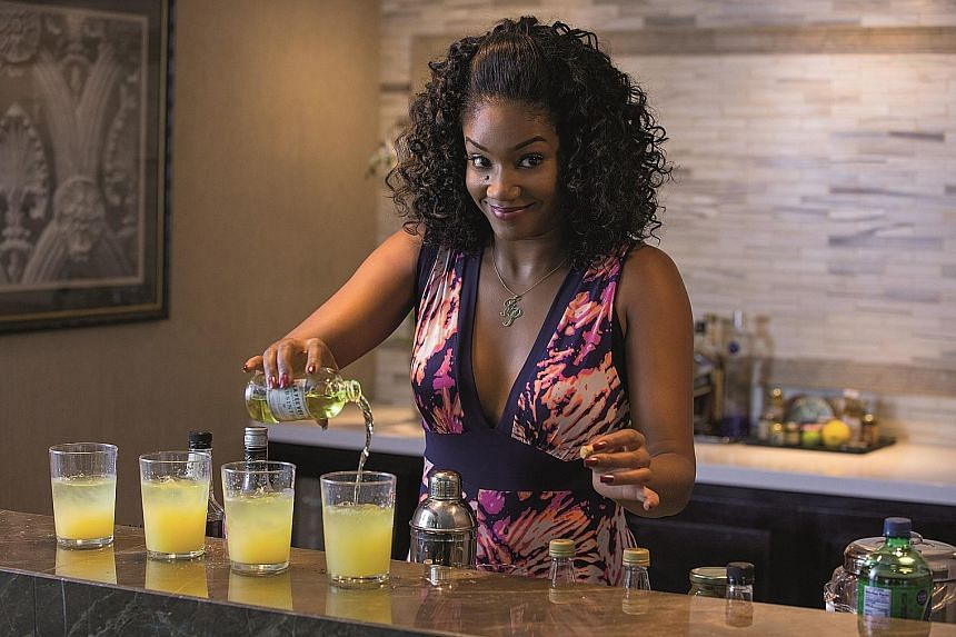 Tiffany Haddish has a raunchy scene with fruit props in Girls Trip.