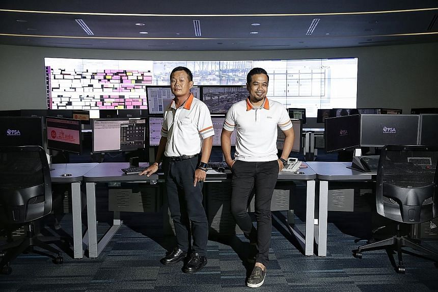 Mr Kenny Tan (left), a 51-year-old container equipment specialist, and Mr Mohamed Khairul, a 30-year-old operations controller, are enjoying their new roles after moving from from Tanjong Pagar Terminal to Pasir Panjang Terminal last year.