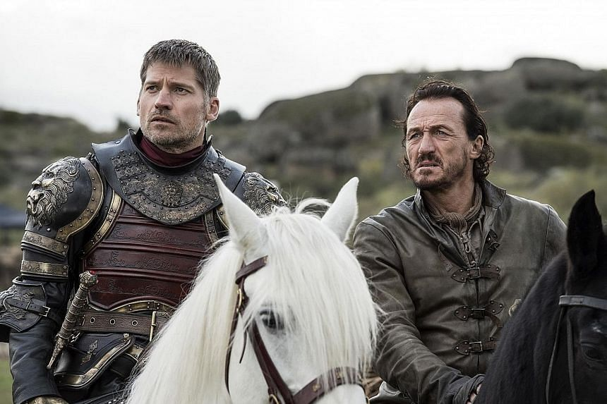 A hacker released material from Game Of Thrones, which stars Nikolaj Coster-Waldau (far left) and Jerome Flynn, that had been stolen from HBO.