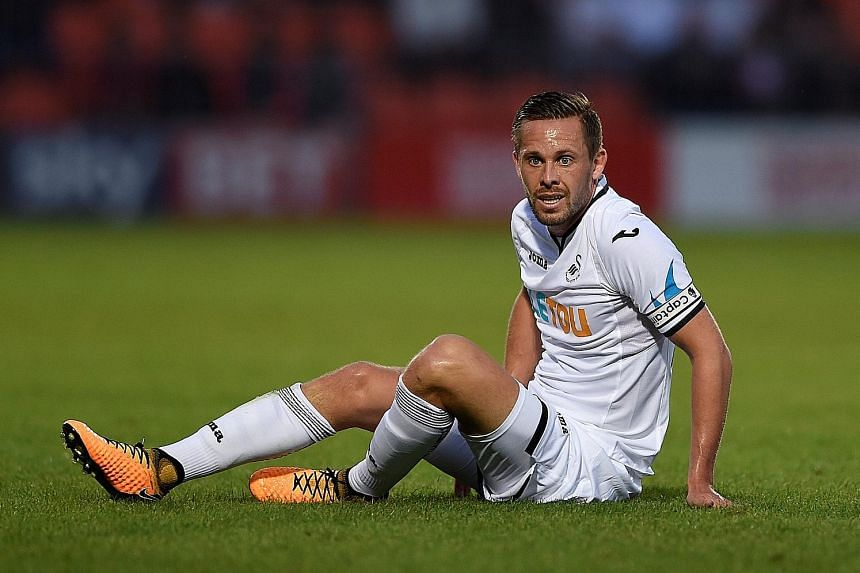 Swansea midfielder Gylfi Sigurdsson is in limbo, having been left out of the Swans' league opener against Southampton, with a mooted move to Everton yet to materialise.