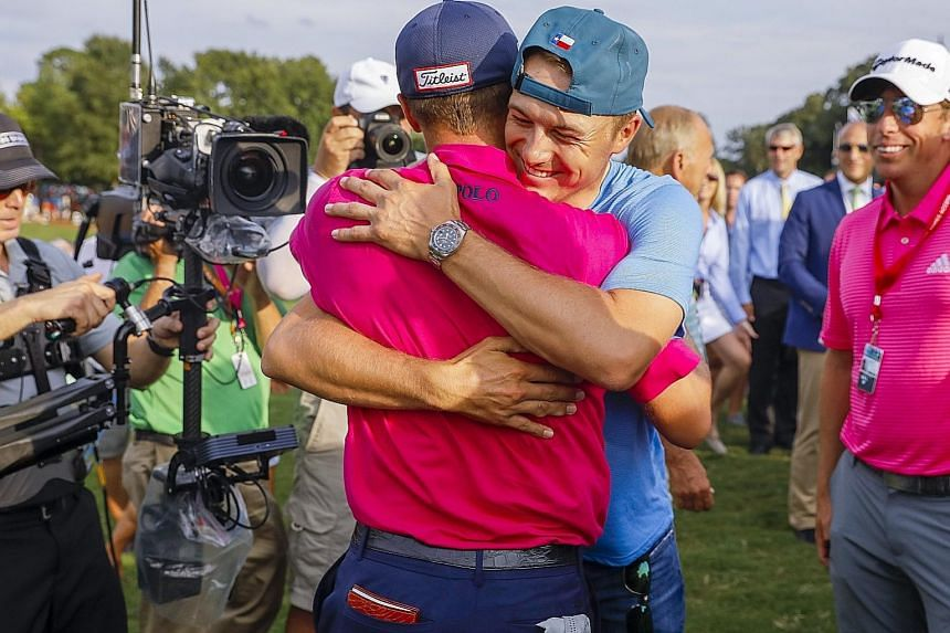 Jordan Spieth hugging PGA Championship winner Justin Thomas (in pink). The British Open champion had been the pre-tournament favourite.