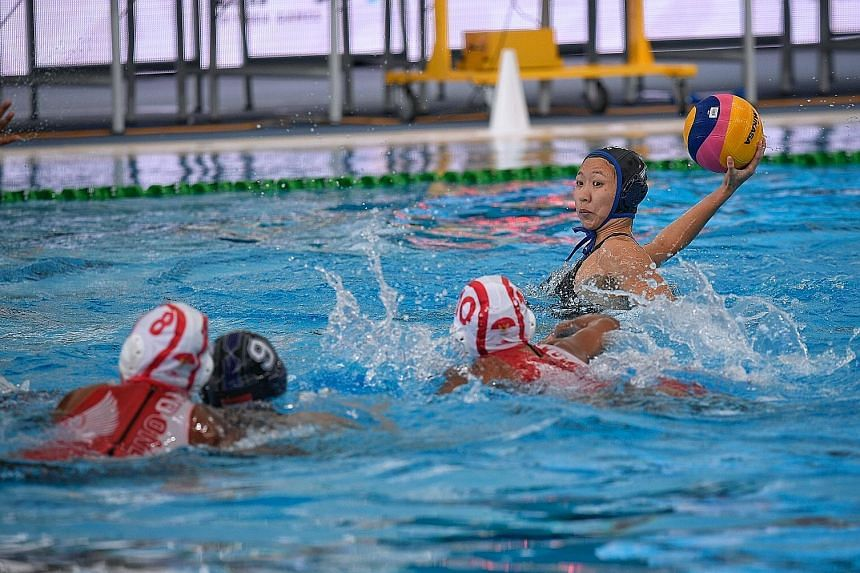 Angeline Teo taking a shot against Indonesia at the National Aquatics Centre in Bukit Jalil. She scored a hat-trick in Singapore's 7-6 win as the team fended off a strong Indonesian comeback in the final period.