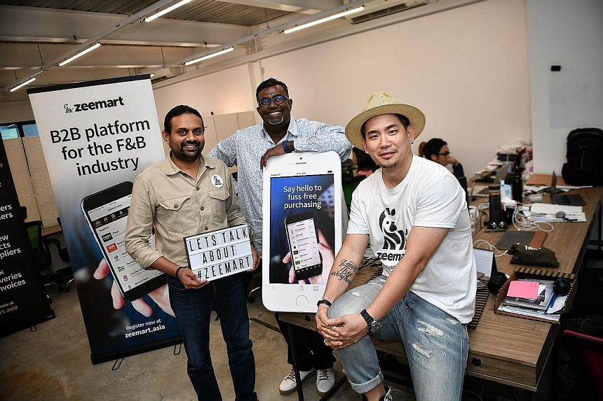 Zeemart co-founders Neeraj Sundarajoo (left) and Keith Tan, and its rainmaker, Mr Prakash Somosundram, are hoping most restaurants in Singapore will use its business-to-business platform. They are targeting to have 1,000 restaurants on their platform
