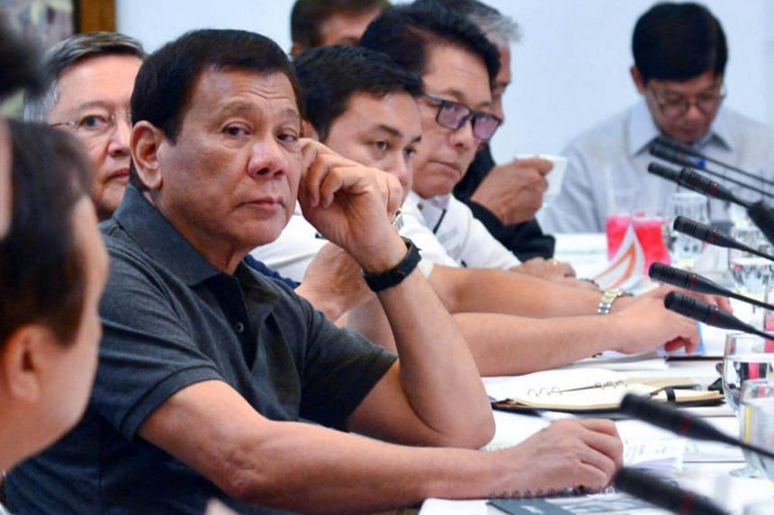 Philippine President Rodrigo Duterte presides over a special cabinet meeting at the Presidential Guest House in Panacan, Davao City, southern Philippines.