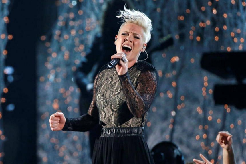 """Pink performs """"Just Give Me A Reason"""" at the 56th annual Grammy Awards in Los Angeles, California, US."""