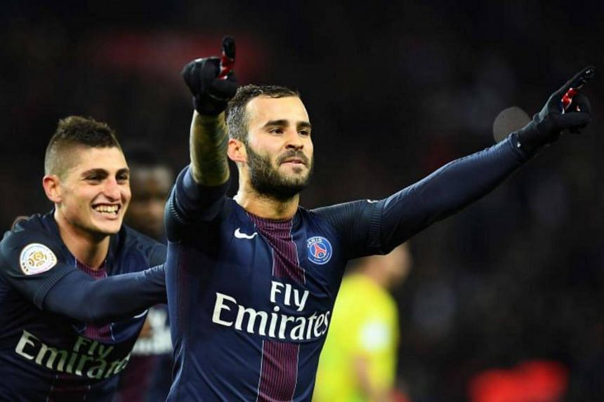Paris Saint-Germain's Spain's forward Rodriguez Jese (right) celebrating after scoring a goal during the French L1 football match between Paris Saint-Germain and Nantes at the Parc des Princes stadium in Paris on Nov 19, 2016.