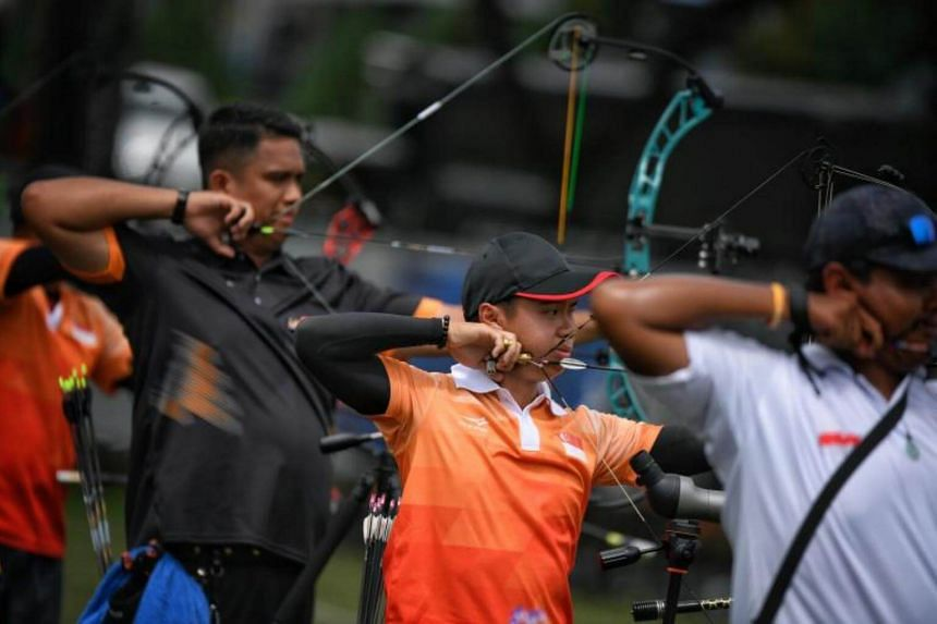 Singaporean archer Ang Han Teng (centre) during the quarter-finals of the men's individual compound event on Aug 16, 2017.