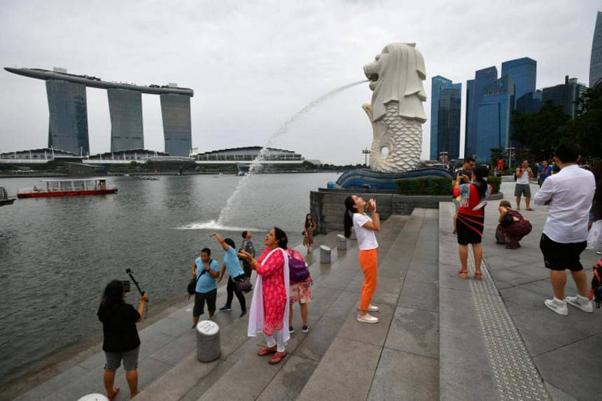 People taking photographs at the Merlion Park on June 19, 2017.