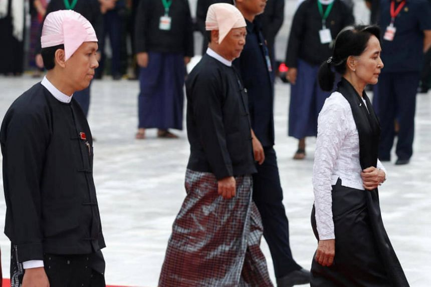 Yangon Chief Minister Phyo Min Thein (left) and Myanmar State Counselor Aung San Suu Kyi attend an event marking the 70th anniversary of Martyrs' Day at the Martyrs' Mausoleum in Yangon, Myanmar on July 19, 2017.