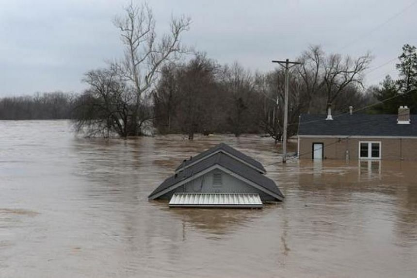 A home is completely submerged in Fenton, Missouri on Dec 30, 2015.
