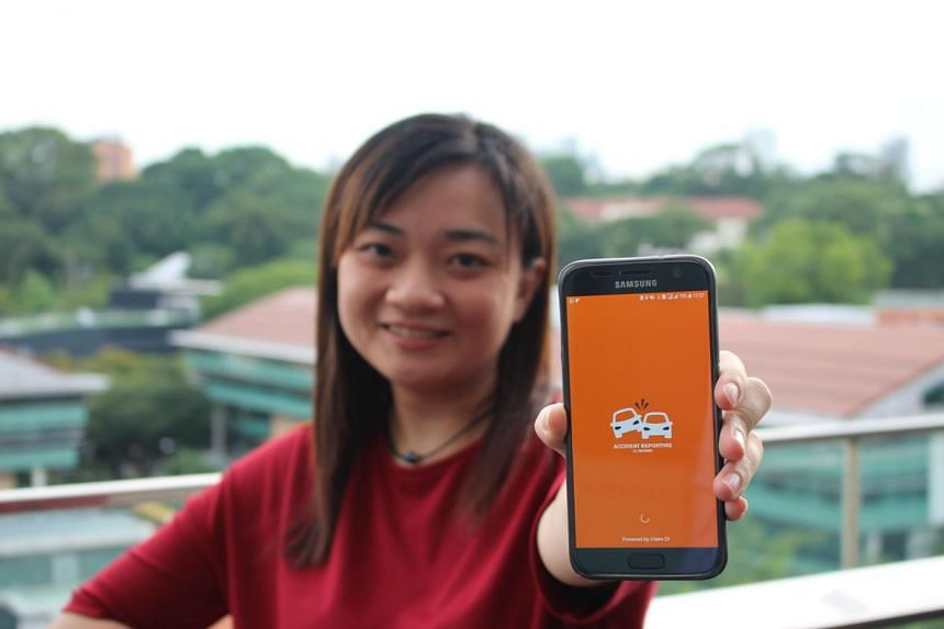 Ms Alina Seah, Income's deputy vice-president of motor insurance, showing the accident-reporting app.